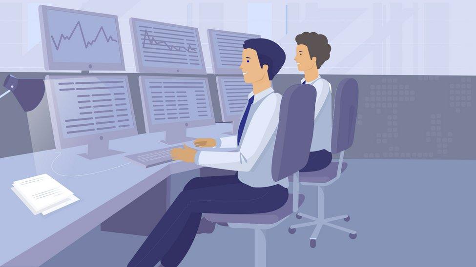 Zwei Spezialisten sitzen an dem Arbeitsplatz beim Handeln